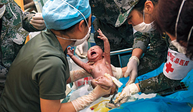 A baby being born in a field hospital
