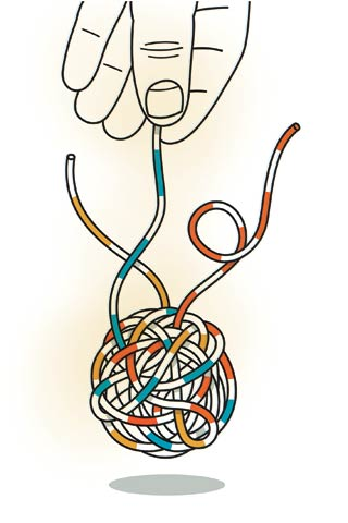 A hand holding a tangled ball of yarn